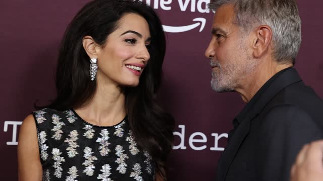 """amal clooney and george clooney attend the los angeles premiere of """"the tender bar"""" presented by amazon studios at dga theater complex on october 03,... - アメリカ監督組合点の映像素材/bロール"""