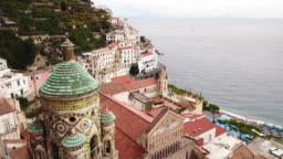 Amalfi, Amalfi Coast, Salerno, Italy. Aerial view of the city, St. Andrew's Cathedral, coastline and the sea