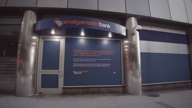 amalgamated bank permanently closed sign by entrance on 52 broadway in lower manhattan. filmed during the coronavirus pandemic when many businesses... - bank stock videos & royalty-free footage