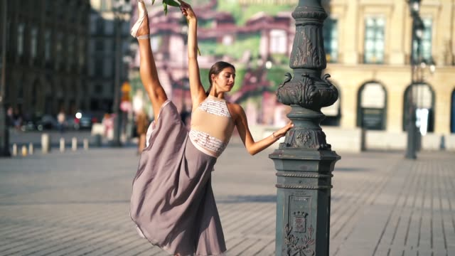 amanda derhy, ballet dancer, wears a leotard from bloch, repetto skirt and shoes, and performs dance moves, on september 9, 2018 in paris, france. - gymnastikanzug stock-videos und b-roll-filmmaterial