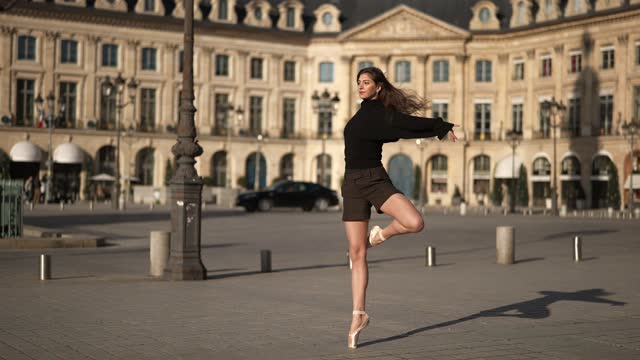 amanda derhy wears a black cropped oversized pullover / sweater from sonia rykiel, a black leotard, brown checked shorts, ballet / ballerina shoes,... - leotard stock videos & royalty-free footage