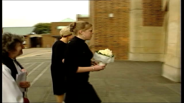 surrey guildford ext bob sally dowler daughter gemma dowler along with canon maureen palmer towards past as arriving at memorial service picture of... - memorial event stock videos and b-roll footage