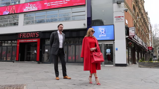 amanda holden and jamie theakston pose outside heart breakfast radio studios as they celebrate the return of heart's 'make me a millionaire'... - arts culture and entertainment stock videos & royalty-free footage
