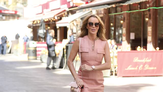 amanda holden leaves global radio studios on april 22 in london, england. - pink colour stock videos & royalty-free footage