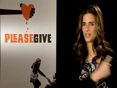 amanda peet on how her fake tan was done in the film and how disgusting it was on how her bath was brown every night at the please give interviews... - amanda peet stock videos & royalty-free footage