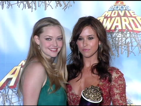 Amanda Seyfried and Lacey Chabert winners of OnScreen Team for 'Mean Girls' at the 2005 MTV Movie Awards press room at the Shrine Auditorium in Los...