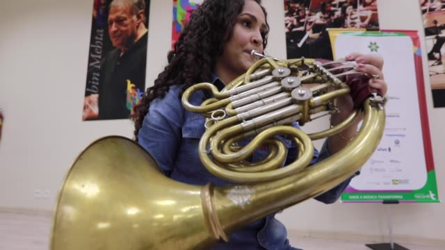 amanda vieira soares plays the horn during a live-stream performance with the baccarelli institute's wind quintet to raise funds for donations at the... - live broadcast stock videos & royalty-free footage