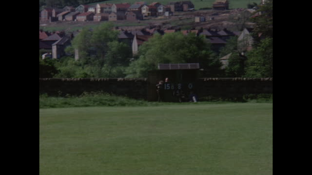 amateur cricket march being played in yorkshire, england circa 1968. - yorkshire england stock videos & royalty-free footage