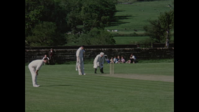 stockvideo's en b-roll-footage met amateur cricket march being played in yorkshire england circa 1968 - sociale geschiedenis