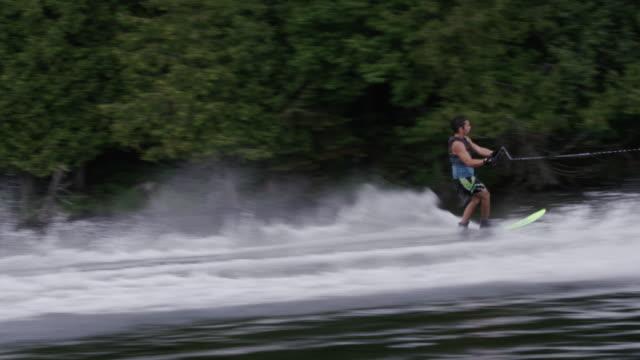 amateur teenage slalom waterskiing waterskier - waterskiing stock videos & royalty-free footage