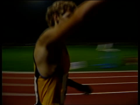 amateur/pro issues in athletics; itn west germany: koblenz: ext cram towards on victory lap l-r to bv - 西ドイツ点の映像素材/bロール