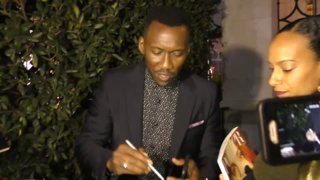 Amatus SamiKarim and Mahershala Ali sign for fans outside Porter Incredible Women Gala 2018 at The Ebell of Los Angeles on October 09 2018 at...