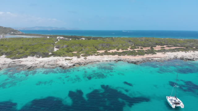 amazing aerial view of beach in ibiza coast, turquoise waters - balearics stock videos & royalty-free footage