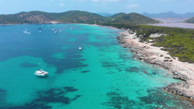 amazing aerial view of beach in ibiza coast, turquoise waters - イビサ島点の映像素材/bロール