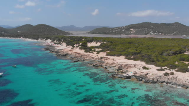 amazing aerial view of beach in ibiza coast, turquoise waters - silvestre stock videos & royalty-free footage