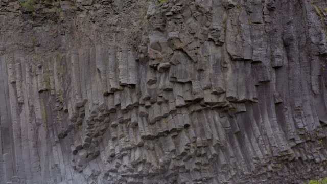 amazing basalt wall in studlagil canyon in east iceland - basalt stock videos & royalty-free footage