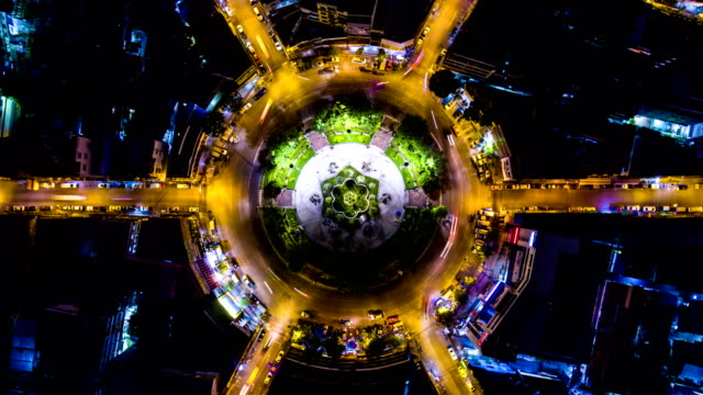 amazing colorful night traffic on circle, overhead shot, aerial time lapse video - awe stock videos & royalty-free footage