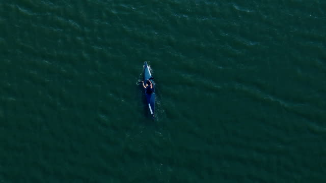 amazing drone shoot of kayaking on the lake - canoe stock videos & royalty-free footage