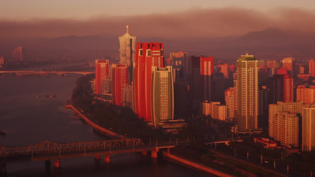 amazing dusk to day at skyline of futuristic buildings at mirae scientists street in pyongyang, north korea, dprk. full moon setting and sun rising. seen from above - north korea stock videos & royalty-free footage