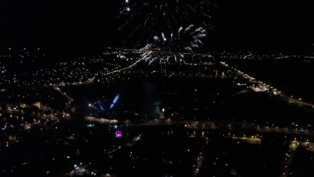 amazing fireworks over the city 4k - midnight stock videos and b-roll footage