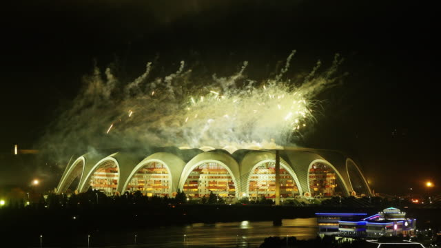 amazing night time-lapse of rungrado may day stadium with firework after the mass games in pyongyang, north korea, drpk - spoonfilm stock videos and b-roll footage
