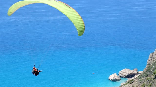 amazing paragliding flight - parachuting stock videos & royalty-free footage