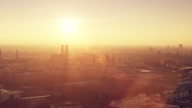 as amazing sunset in munich with the silhouette of the frauenkirche - wop productions stock-videos und b-roll-filmmaterial