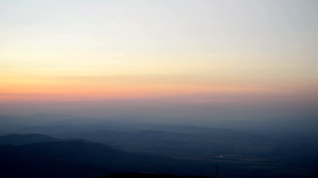 amazing sunset sunrise with sun over dark mountain ground silhouette - horizon over land stock videos & royalty-free footage