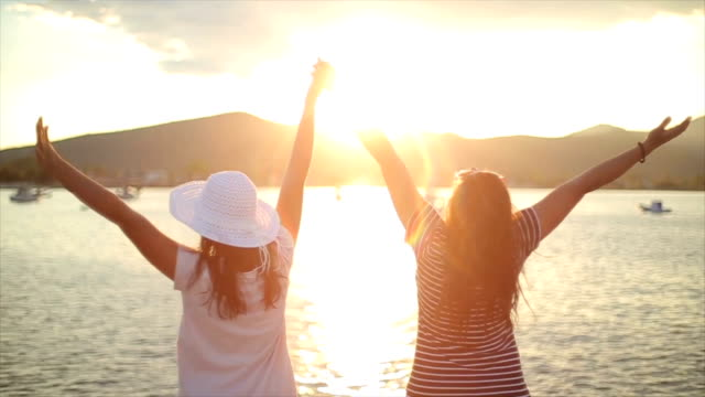 amazing sunset,family concept,mother and teenage daughter together on the summer vacation - multicolore video stock e b–roll