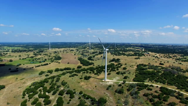 Amazing Texas Hill country spotted with Turbines overlooking aerial drone shot Wind Turbines Farm outside of Goldthwaite , Texas near Lampasses and Austin TX