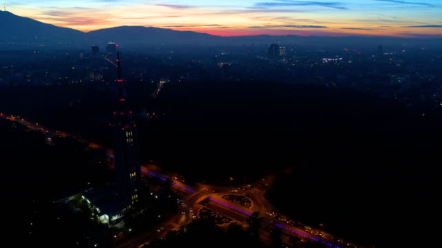 Amazing time lapse drone shot at night of city traffic during rush hour and sunset