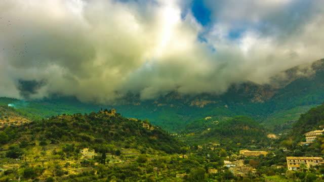 amazing tropical village deya deia valley old church majorca - palma stock videos & royalty-free footage