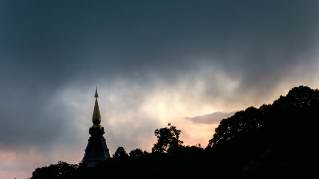 amazing view of doi inthanon pagoda with dramatic sky, chiang mai province, thailand, time lapse video - multicopter stock videos & royalty-free footage