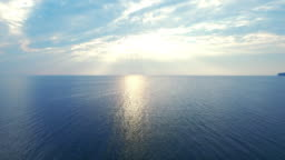 Amazing view sunlight reflecting on sea surface. Drone view blue sea on skyline