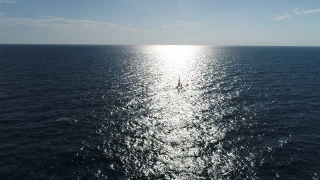Amazing view to Yacht sailing in open sea at windy day aerial view