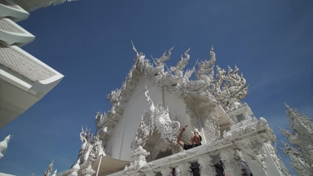 amazing wat rong khun (white temple), chiang rai, northern thailand, thailand, southeast asia, asia - temple building stock videos & royalty-free footage