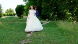Amazing wedding couple walks, looks on each other and posing . Slowly