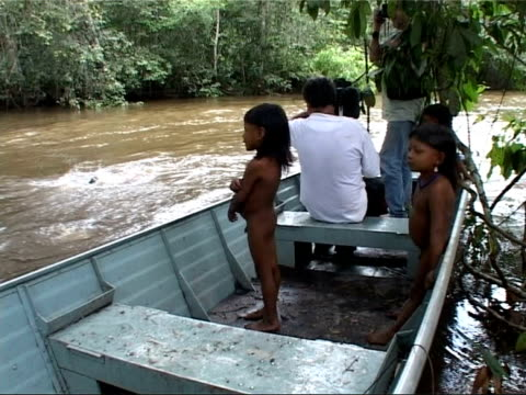 Cuiaba city / Aerial views of Amazon Rainforest / Enawene Nawe Indian village Children climbing trees / crew member with young children in boat...