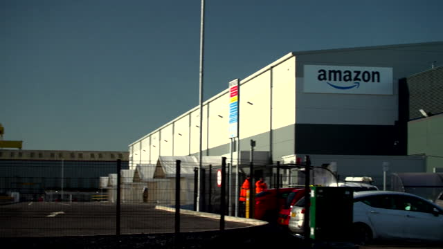 amazon factory and vehicles in belfast - warehouse stock videos & royalty-free footage