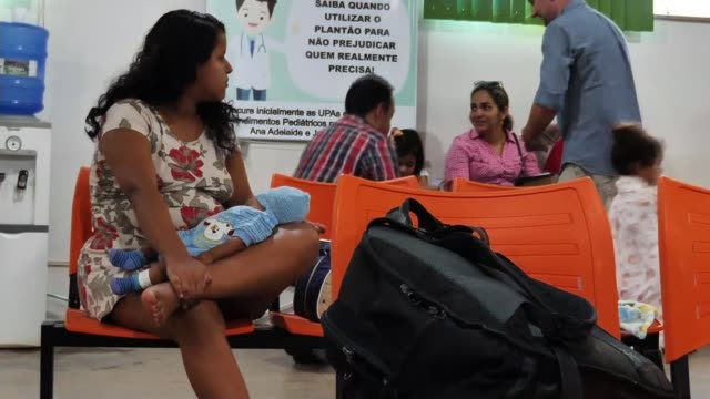 brazil refuses aid unless french president apologises brazil int various shots mothers with children in hospital waiting room unnamed mother... - latin america stock videos & royalty-free footage