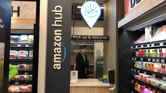 amazon hub, inside amazon fresh supermarket, ealing broadway, that allows pick ups and returns from the main amazon website - shop stock videos & royalty-free footage