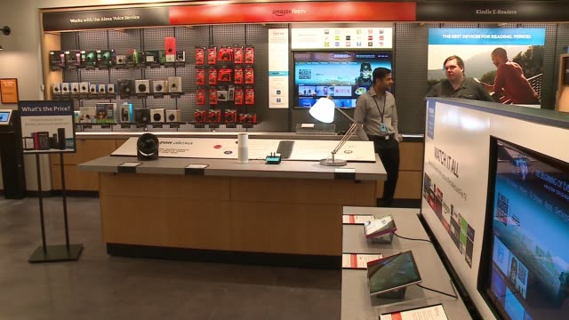 wgn amazon opened the doors of a brickandmortar store in chicago's lakeview neighborhood giving customers a chance to test the ecommerce giant's take... - amazon fire phone stock videos & royalty-free footage