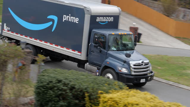 amazon prime truck delivering in the suburban community of atlanta in the autumn amid the 2020 global coronavirus pandemic - heavy goods vehicle stock videos & royalty-free footage