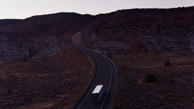 amazon prime truck on hwy 89 in utah - drone shot - winding road stock videos & royalty-free footage