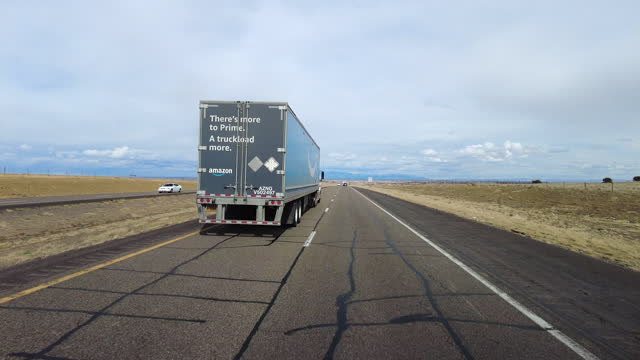 amazon prime truck on the interstate 40 traffic in arizona section amid the covid-19 pandemic. - scenics stock videos & royalty-free footage