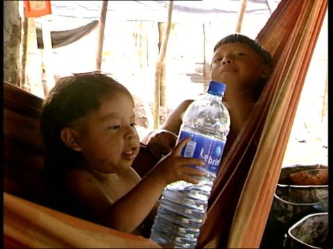 Enawene Nawe Indian village / Aerial shots of forest BRAZIL Amazon Rainforest EXT Various shots of indigenous Enawene Nawe Indian men and children...