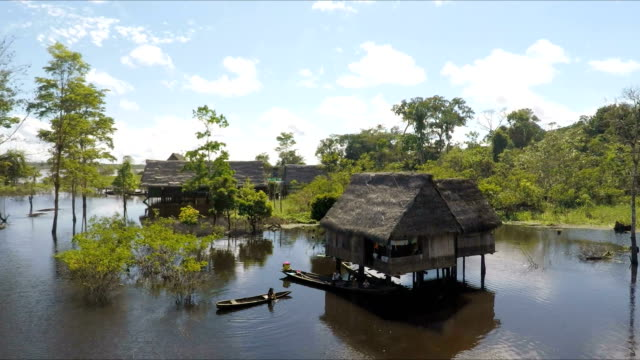 amazon village and young girl on river skiff, peruvian amazon, peru - village stock videos & royalty-free footage