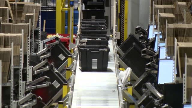 vídeos y material grabado en eventos de stock de amazon warehouse in tilbury crates full of products on production line - cajón para embalar