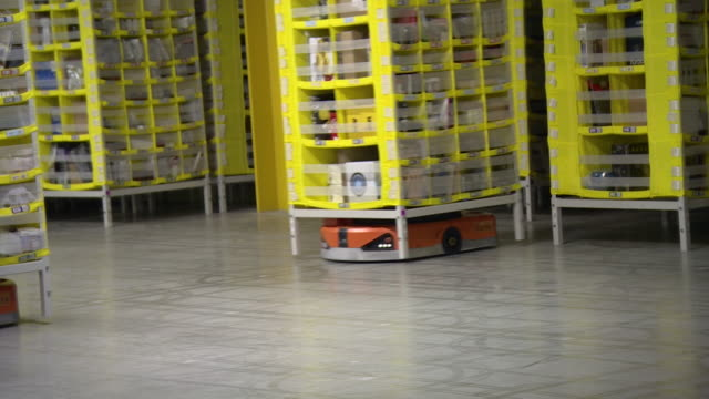 amazon warehouse in tilbury robotic automated shelving units full of products - production line stock videos & royalty-free footage