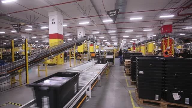 stockvideo's en b-roll-footage met amazoncom inc fulfillment center kiva systems llc robots in passo corese rieti italy on thursday july 26 2018 - kiva